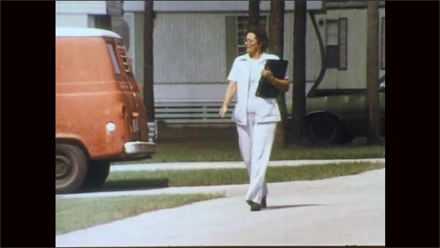 1970s: Liquid drains from bottle. Woman staples poster up. Nurse holding clipboard walks down street. Nurse knocks on trailer door. Woman answers door with children at her side.