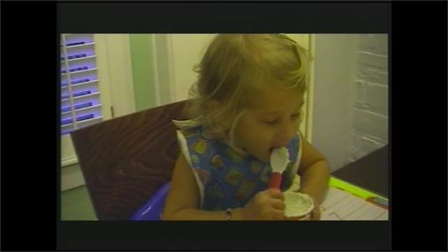 1990s: Person cuts pizza.  Little girl eats ice cream.