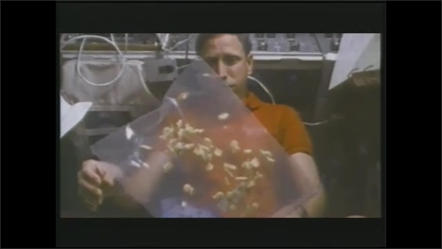 1990s: Food is packaged in lab.  Astronauts play with food in space.
