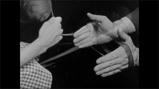 1950s: Man puts saddle on horse.  Carving set.  Hands hold and roll yarn into ball.  Hands play violin.  Tennis racket.  Woman serves ball.