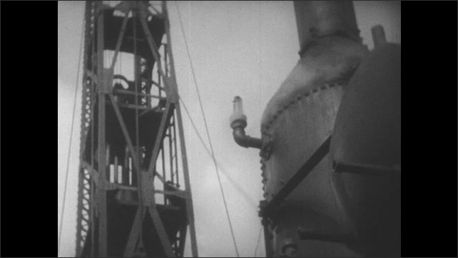 1950s: Man watches pile driver in action. Smoke coming out of steam engine while pile driver worker. Man in white suit at laboratory table holds bottle of vinegar and box of baking soda.