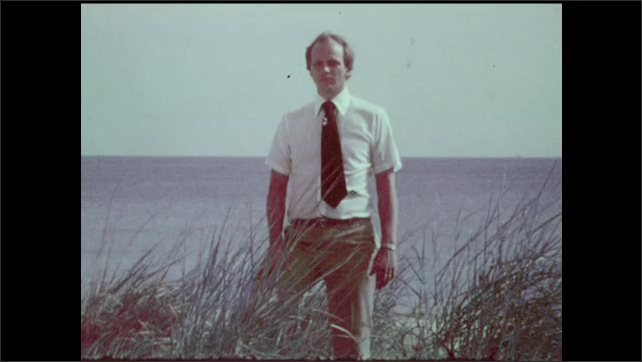 1970s: Man in tie stands in front of bicycle and picnic shelter in woods. Man in tie in front of ocean shore. Corp workers collect litter off of beach.