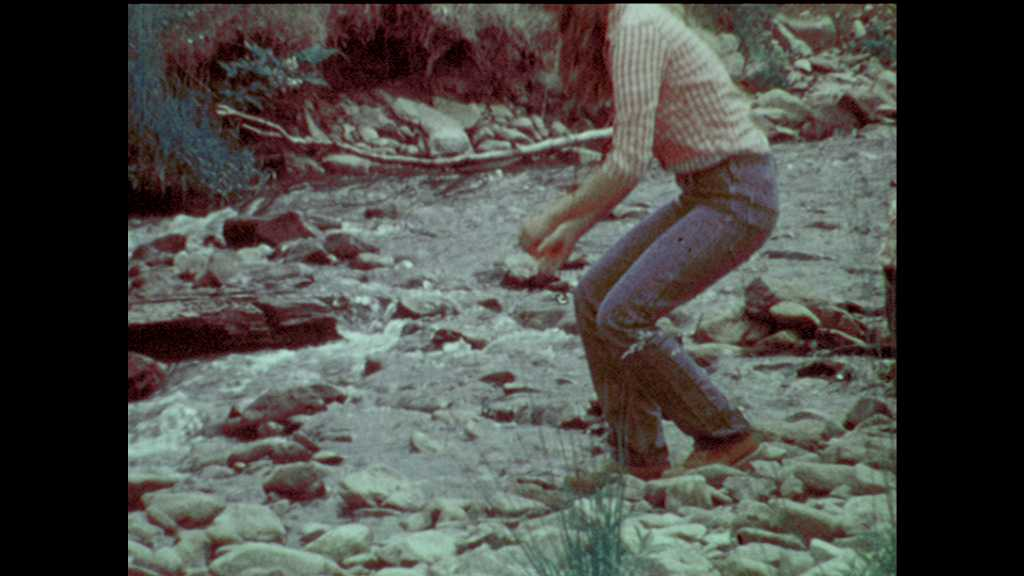 1970s: Youth Conservation Corps collect water samples from streams. Young woman shows samples to group of Corp members. Boat comes ashore.
