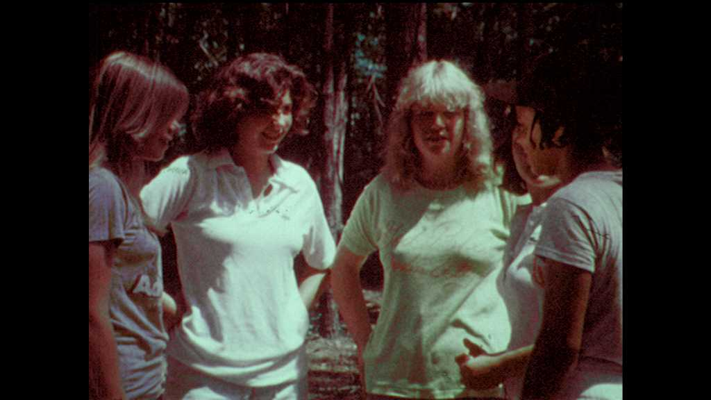 1970s: Young women form a circle and hug. Youth Conservation Corp members speak lines.