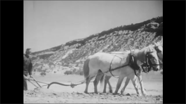 1930s: Mother and daughter plant squash seeds in the dirt. Horse plows the dirt and a father sows corn seeds.