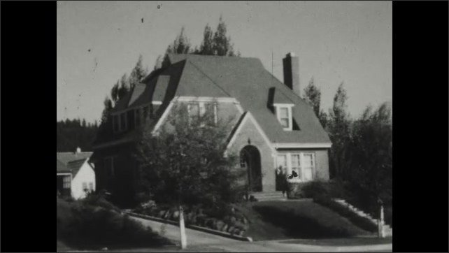 1930s: Exterior of house with lawn and trees.