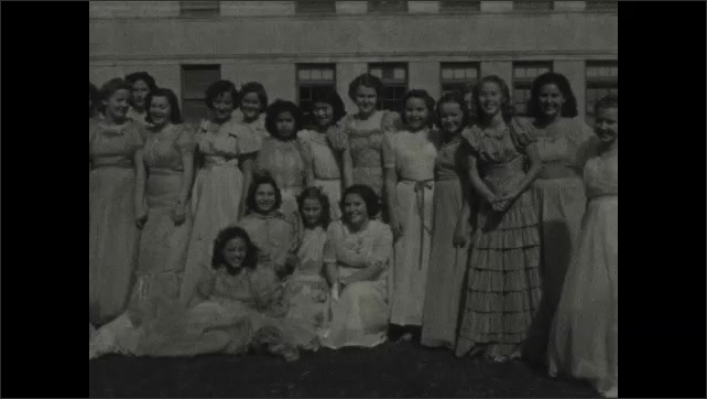 1930s: Young women dressed up as Native Americans run across lawn. Group of women pose together outside.