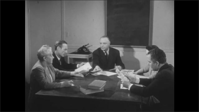 1950s: group of men meeting about audio-visual education in church