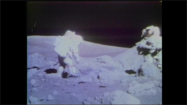 1990s: Rocket launching. Footage of astronauts on moon. Astronauts with equipment on moon.