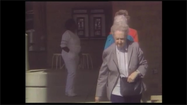 1990s: Man in spacecraft running on treadmill. Elderly woman walking. View of Earth from space.