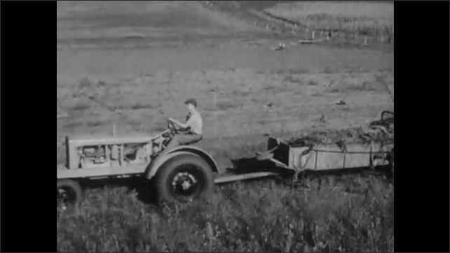 1930s: Tractor pulls rototiller over dusty field. Tractor pulls plow with cart over field. Mounds of dirt litter field.