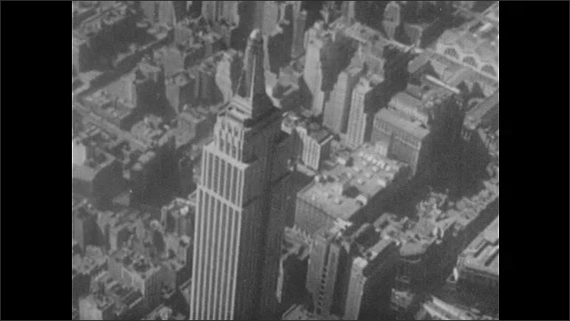 1940s: City.  Empire State Building.  Chrysler Building.