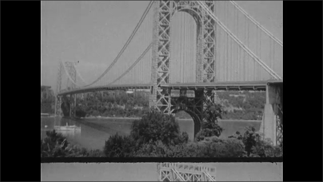 "1940s: George Washington Bridge.  Hudson River.  Street sign reads ""TIMES SQ., W. 42 ST.""  Busy street."