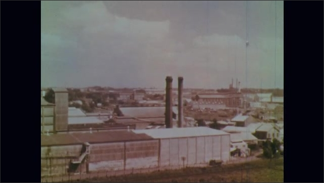 1950s: View of museum. View of tall building. View of factory. Train  on train track.