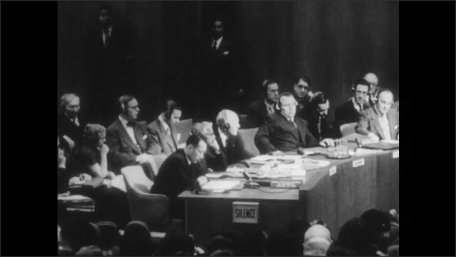 1950s: UNITED STATES: Communist man speaks to delegates. Chinese man speaks to UN members.