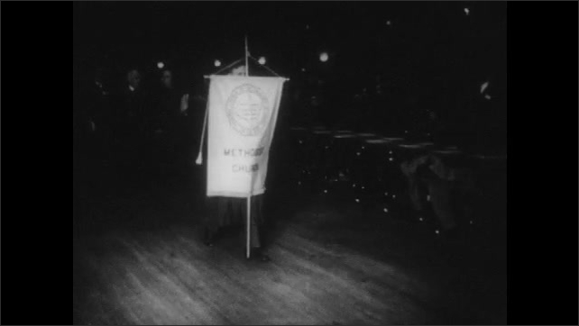 1950s: UNITED STATES: church members carry flags of America. Interdenominational council meets at summit
