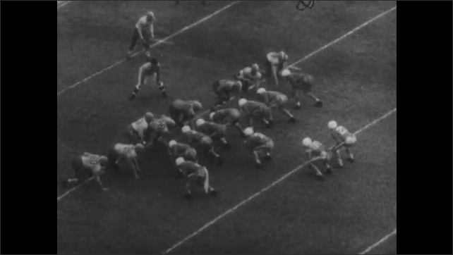 1950s: UNITED STATES: men line up in match. Tennessee player passes ball in match. Team wins  match.