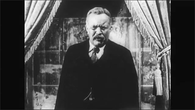 1950s: Sidney Blackmer plays Theodore Roosevelt, speaks emphatically, looks angry, shakes fists, stands in living room in front of window, snow falls outside. American flag waves.