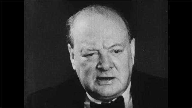 1940s: Men throw wreckage from Nazi airplanes into piles in junkyard. Winston Churchill talks.