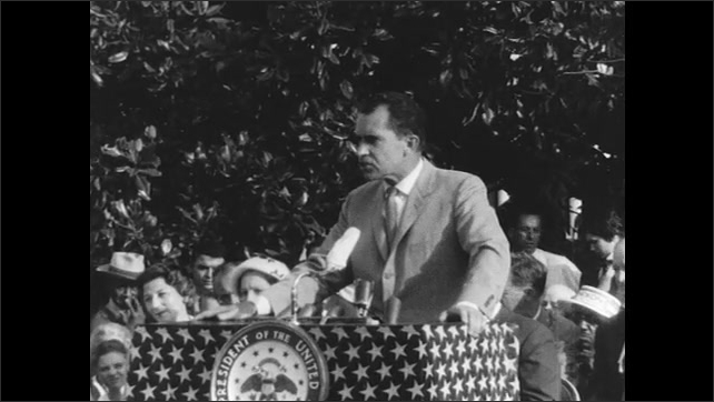 People Sit Behind and Listen to Vice President Nixon as he Addresses Audience