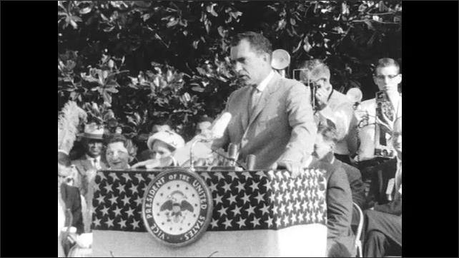 People Clap and Cheer as Nixon Speaks