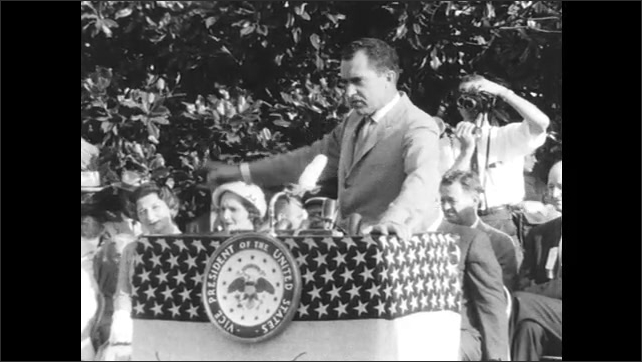 Photographer Moves to get Better View as Nixon Speaks to Crowd