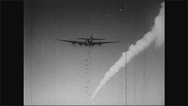 """1940s: Text reads """"MAY 1944.""""  Planes drop bombs.  Explosions."""