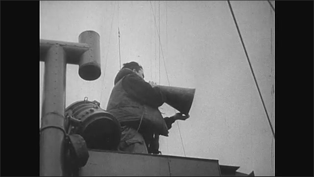 1940s: Normandy, Europe: soldier speaks on phone on deck of ship. Troops prepare to land. Soldiers jump into sea. Soldiers head for land.