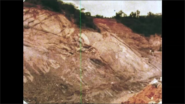 1980s: UNITED STATES: soil and minerals in quarry. African landscape. Rock in quarry.