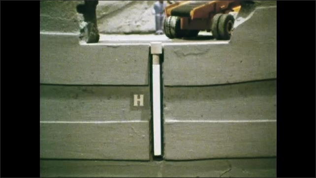 1980s: UNITED STATES: Mined geologic repository title. Man made barriers. Finger points at model