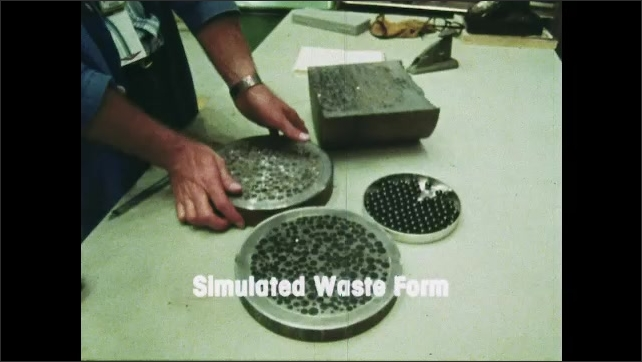 1980s: UNITED STATES: Simulated waste form title. Glass and waste powder in calciner. Glass waste. Hand holds glass disc