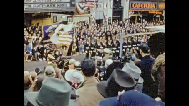 1940s: People in uniforms in parade perform military cadence for audience. People watch parade. Title card for military officers.