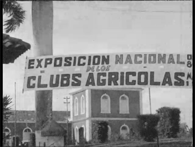 Cuba 1940s: Boy and girl dance and take bow. View of sign. Crowd walks toward building.