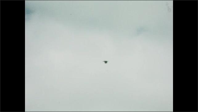 1930s: UNITED STATES: bird flies in sky. Bird glides in sky. Bird flies in sky