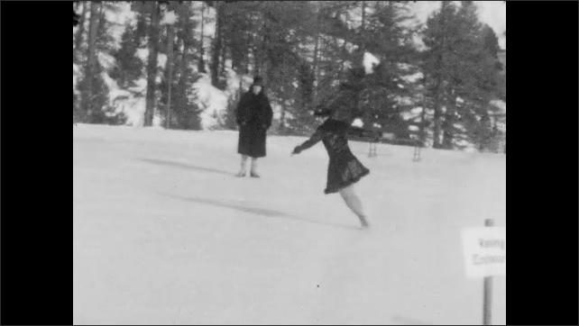 1940s: Panning shot, woman skating on pond.