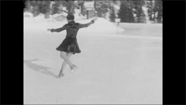 1940s: Panning shot, woman skates past people on ice. Woman does jump on ice. Long shot, woman skates on ice rink.