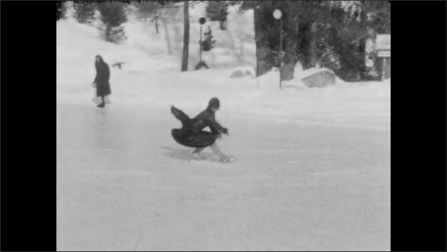 1940s: Shots of woman skating on pond.