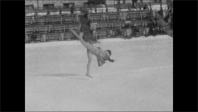 1940s: Slow motion, woman skating backwards on ice.