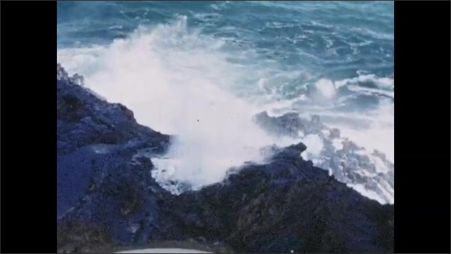 """1940s: Caption reads """"BLOW HOLE, AN OCEAN ODDITY.""""  Waves crash on rocks.  Water spurts up through hole."""