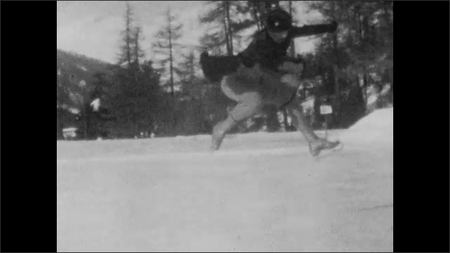 1940s: Slow motion of woman ice skating, woman does jump.