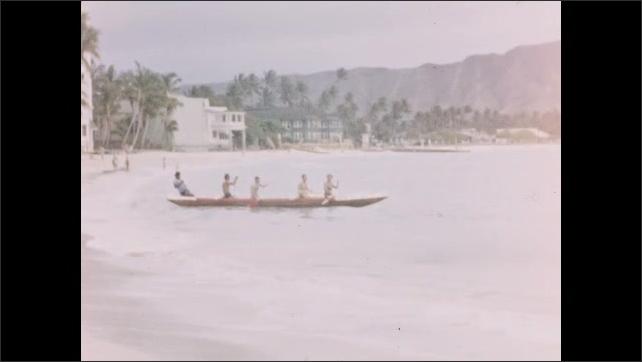 1940s: Mountains.  Ocean.  Men row boat to shore.