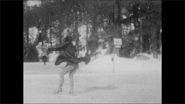 1940s: Slow motion, woman ice skating, woman spins.