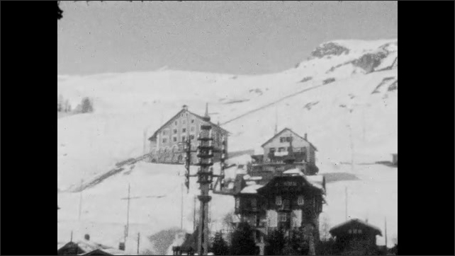1940s: Woman eating, looks at camera. Pan across buildings on mountain. Man posing next to sculpture.
