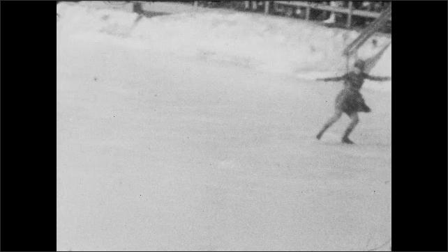 1940s: Panning shot, woman skating on ice rink.