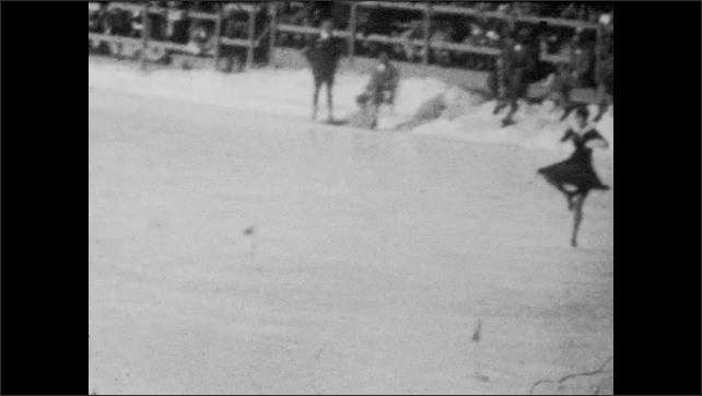1940s: Panning shots, woman skating on ice rink.
