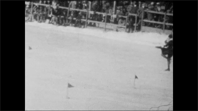 1940s: Crowd at ice rink. Long shot, woman skating on ice rink.