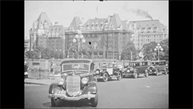 1940s: CANADA: passengers board boat. View of port from boat. Car drives in city street. Police man in city street. Lady crosses road