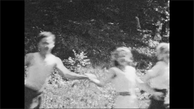 1940s: People hold hands and dance in circle.  People run race.