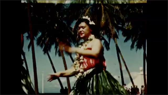 1950s: Hula dancers perform. Musicians play and man sings and dances.