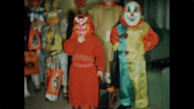 1950s: Children in Halloween costumes.